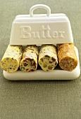 Various rolls of spiced butter