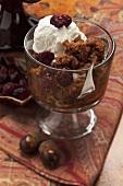 Indian pudding (polenta pudding with raisins and vanilla ice cream, USA)