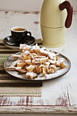 Crostoli (deep fired Italian pastries with icing sugar)