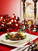 Venison medallions in a honey sauce with walnuts