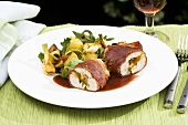 Stuffed chicken breast with apricots wrapped in bacon