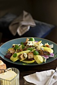 Warm pear and walnut salad with blue cheese and croutons