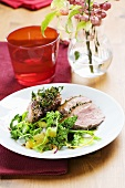 Goose breast with a thyme crust and orange savoy cabbage