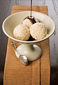 Nougat dumplings with an almond coating