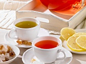 Rosehip tea and green tea with candied sugar and lemons