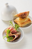 A puff pastry pocket with figs and duck breast