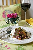 Fish with red wine sauce, olives and rice (Mexico)