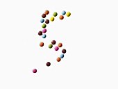 The number 5 made of coloured chocolate beans