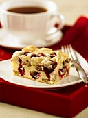 A piece of cranberry and nut cake