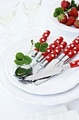 Red and white polka dot cutlery on a plate