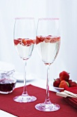 Strawberry punch in champagne glasses with a sugared rim