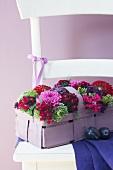 Spankörbchen mit Blumen gefüllt