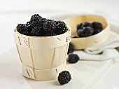 Fresh blackberries in a wood chip basket