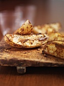 Potato wedges on a wooden board