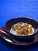 Turkey curry on rice in a small bowl