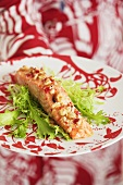 Salmon steak with chilli nut crust