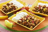 Chili con carne with sour cream in corn shells