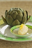 Lemon butter with an artichoke