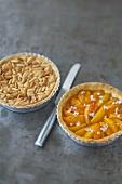 Pine nut tart and apricot tart