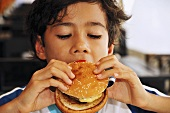 Boy eating hamburger