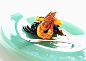Tiger prawns with black linguine and garlic cream