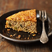 A piece of pumpkin and pistachio cake