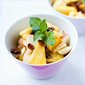 Fruit salad with raisins and mint