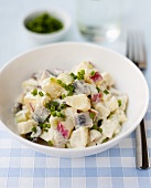 Potato, herring and apple salad with chives