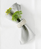 Fabric napkin with napkin ring and dill