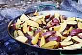 Potato wedges in frying pan