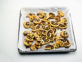 Palmiers with tapenade on a baking tray