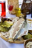 Sea bass with savoy cabbage baked in salt crust