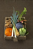 Assorted vegetables in wooden box