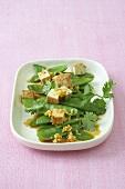 Asian mangetout salad with marinated tofu cubes