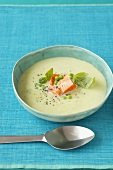 Green asparagus soup with salmon and basil