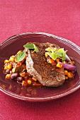 Fried rump steak on sweetcorn and beans