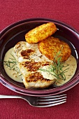 Pork loin steak with mustard sauce and rösti cakes