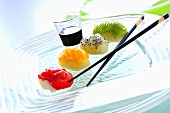 Sushi with strawberries, mango, pitahaya & kiwi, chocolate sauce