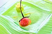 Pistachio mousse with raspberry sorbet, mango coulis & chocolate tulip