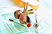Rack of lamb stuffed with asparagus & carrots, squid ink pasta