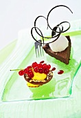 Brownie cake and vanilla mousse with redcurrants
