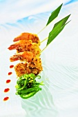 Deep-fried breaded prawns with wakame salad