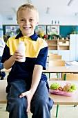 Boy drinking milk at school