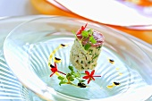 King crab cake with edible flowers