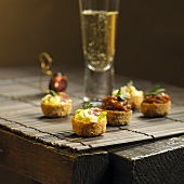 Pancetta & leek and aubergine & caviar tartlets with sparkling wine