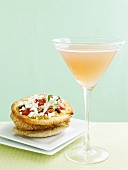 Peach Cosmopolitan and mini-pizza