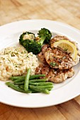 Veal escalopes with risotto, green beans and broccoli