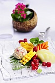 Exotic fruit salad with berries and coconut fruit ice cream