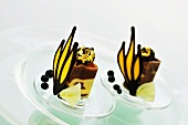Two chocolate desserts with gilded chocolates