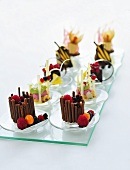 Assorted chocolate and fruit desserts on a glass platter